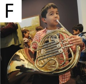 F boy playing french horn